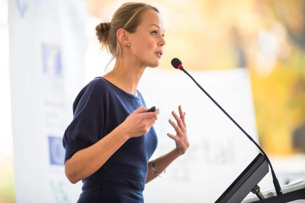 Keynote speaker at a business seminar