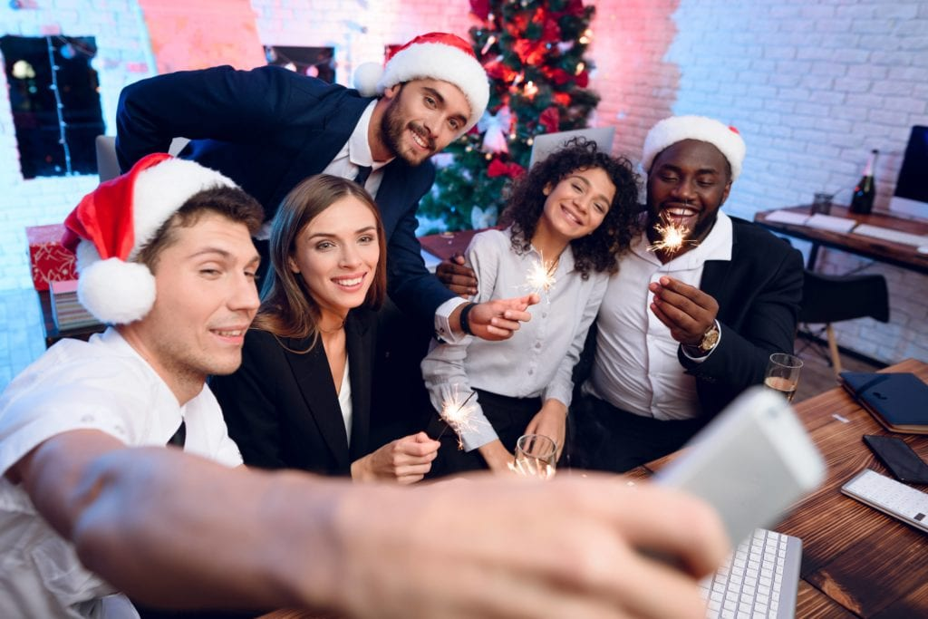 Taking a selfie at a Christmas party