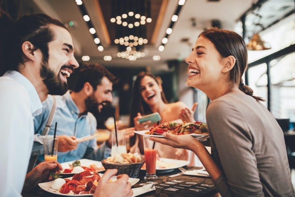 People enjoying food at a restaurant
