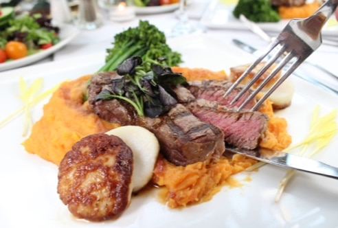 Fillet and scallops over sweet potato mash