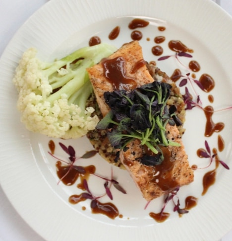 Grilled salmon over rice with a teriyaki drizzle